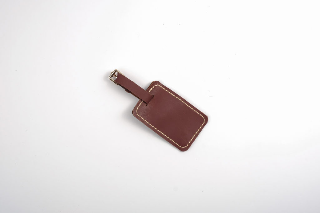 Bespoke With Joy Leather Luggage Tag (brown) — A favorite for avid travelers. This luggage tag is as sturdy as they come. This item can be monogrammed with the giftee's initials. Please indicate your request at checkout.