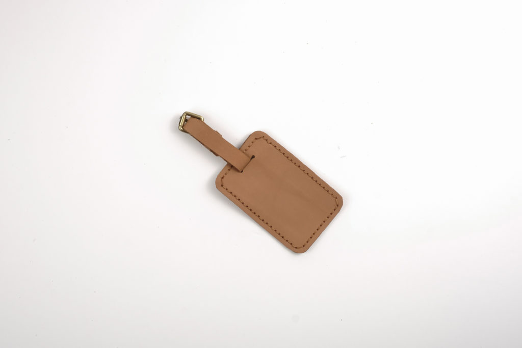 Bespoke With Joy Leather Luggage Tag (light brown) — A favorite for avid travelers. This luggage tag is as sturdy as they come. This item can be monogrammed with the giftee's initials. Please indicate your request at checkout.