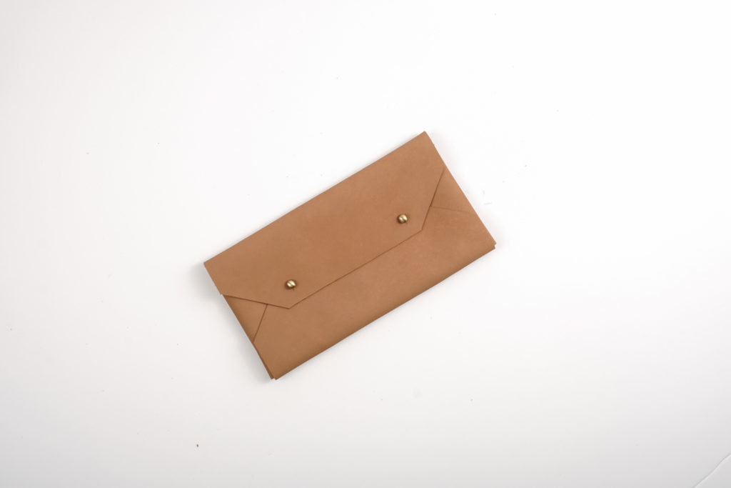 Bespoke With Joy Leather Envelope Clutch (Light Brown) — A leather clutch ideal for quick storage of cash and cards. This item can be monogrammed with the giftee's initials. Please indicate your request at checkout.