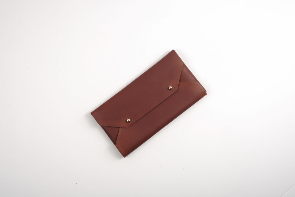 Bespoke With Joy Leather Envelope Clutch (Brown) — A leather clutch ideal for quick storage of cash and cards. This item can be monogrammed with the giftee's initials. Please indicate your request at checkout.