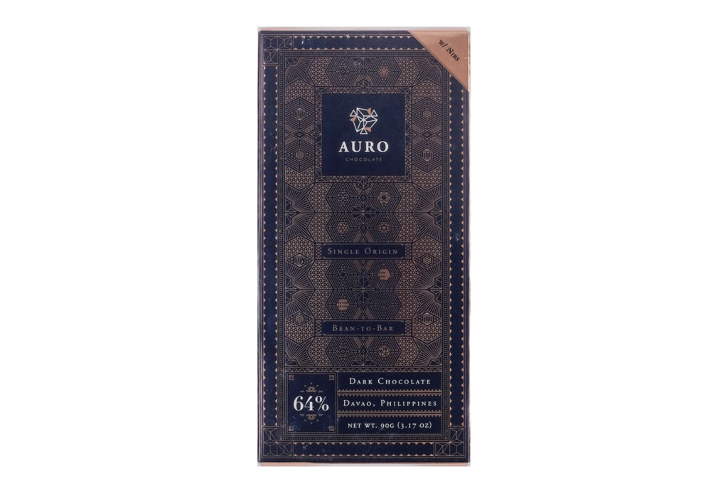 Auro 64% Dark Chocolate Bar with Nibs (90G Bar) — Davao-origin, bean-to-bar chocolate bursting with pronounced cocoa flavors and vibrant fruity notes sprinkled with cocoa nibs for an added crunch. Shelf Life: One (1) year from date of production; see consume before date label.
